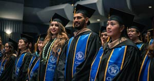 students at graduation in cap and gowns