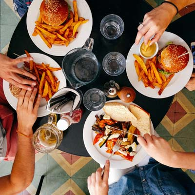 group of people eating food together.