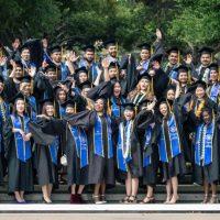 diverse graduate students graduating at university commencement